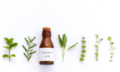 essential oil bottle with plants